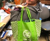 Amy Roskilly showing off her reusable shopping bags.