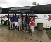 Bus tour huddled under shelter...the tour must go on!